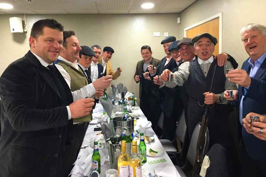 Dalvey Cup Club members propose a toast to absent friends at an evening dinner