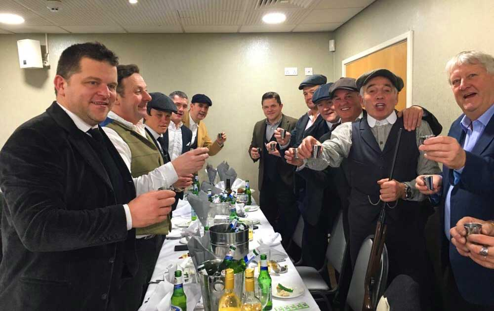 Dalvey Cup Club members propose a toast to absent friends at an evening meal
